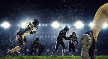 Football players during a game while it is snowing